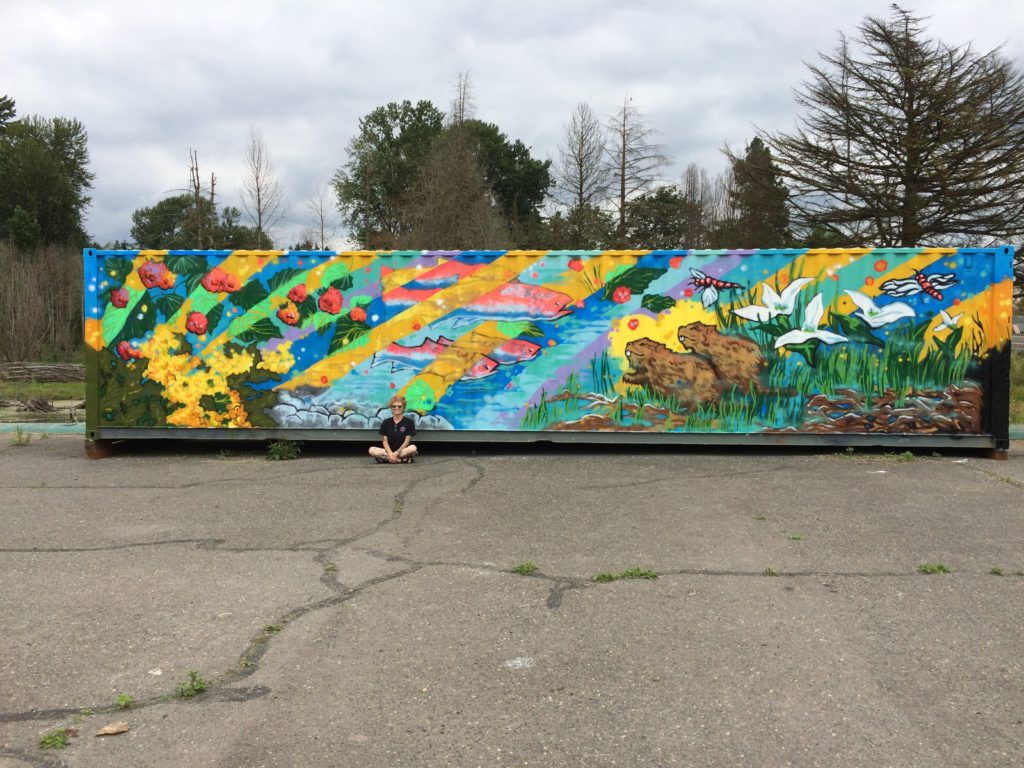 Artist Danielle DeMuro with completed mural